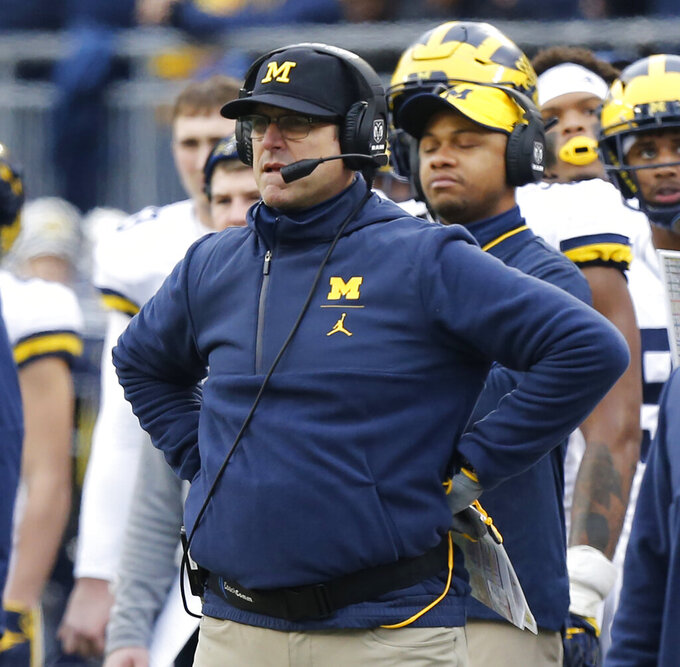 FILE - In this Nov. 24, 2018, file photo, Michigan head coach Jim Harbaugh watches from the sidelines during the first half of an NCAA college football game against Ohio State in Columbus, Ohio. The Buckeyes already have locked up the East Division, so they likely would survive a loss to Michigan if they win the conference championship game. But the Wolverines, 0-4 against Ohio State under Jim Harbaugh and losers in 14 of the last 15 in The Game, would love to cause their rival even just a little anxiety.  (AP Photo/Jay LaPrete, File)