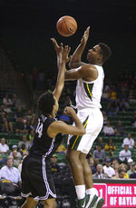Baylor guard Mark Vital (11) attempts a shot over Central Arkansas guard Eddy Kayouloud (14) in the first half of an NCAA college basketball game Tuesday, Nov. 5, 2019, in Waco, Texas. (AP photo/ Jerry Larson)