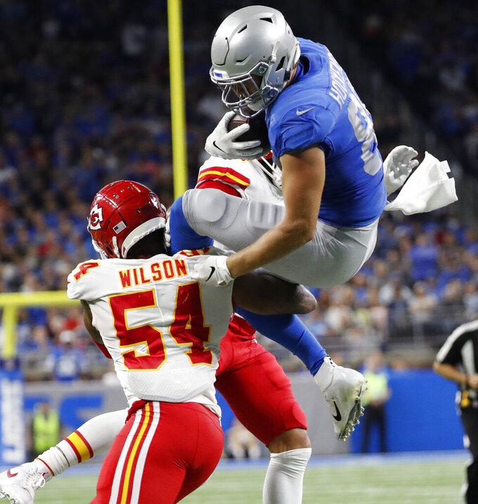 Detroit Lions tight end T.J. Hockenson (88) attempts a jump over Kansas City Chiefs outside linebacker Damien Wilson (54) during the second half of an NFL football game, Sunday, Sept. 29, 2019, in Detroit. Hockenson was injured on the play and carted off the field. (AP Photo/Rick Osentoski)