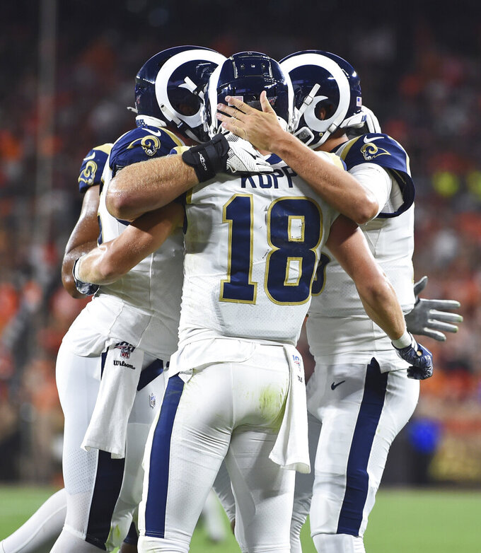Los Angeles Rams wide receiver Cooper Kupp is congratulated by teammates after scoring a touchdown during the second half of an NFL football game against the Cleveland Browns, Sunday, Sept. 22, 2019, in Cleveland. (AP Photo/David Dermer)