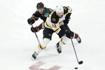 Boston Bruins' Charlie Coyle (13) shields the puck from the Arizona Coyotes' Jakob Chychrun (81) during the second period of an NHL hockey game Saturday, Oct. 5, 2019, in Glendale, Ariz. (AP Photo/Darryl Webb)