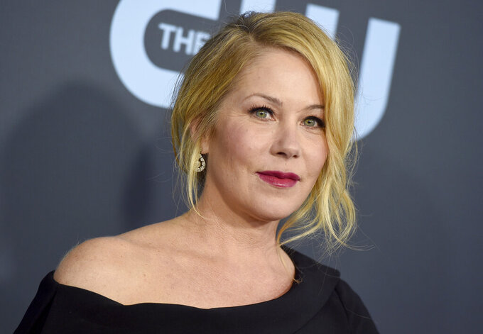 """FILE - Christina Applegate arrives at the 25th annual Critics' Choice Awards on Jan. 12, 2020, in Santa Monica, Calif. Applegate has announced that she has multiple sclerosis, describing her diagnosis as a """"tough road."""" The 49-year-old actor known for her roles in """"Married... with Children"""" and """"Dead to Me,"""" said in a tweet late Monday that she was diagnosed """"a few months ago."""" (Photo by Jordan Strauss/Invision/AP, File)"""