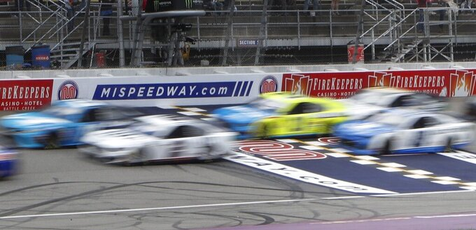 Drivers race at the NASCAR cup series auto race at Michigan International Speedway, Monday, June 10, 2019, in Brooklyn, Mich. (AP Photo/Carlos Osorio)