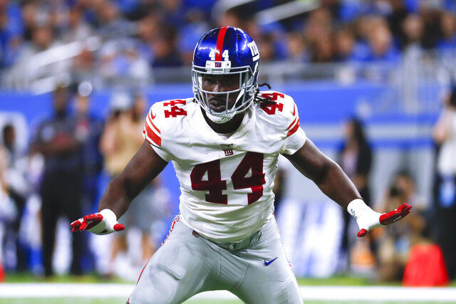 FILE - In this Oct. 27, 2019, file photo, New York Giants linebacker Markus Golden plays against the Detroit Lions during an NFL football game in Detroit. Free agency has not been good to linebacker Markus Golden. The 29-year-old pass rusher had to settle for a one-year deal from the New York Giants in 2019 because he was coming off a so-so season with the Arizona Cardinals following a major knee injury in 2017.  (AP Photo/Paul Sancya, File)