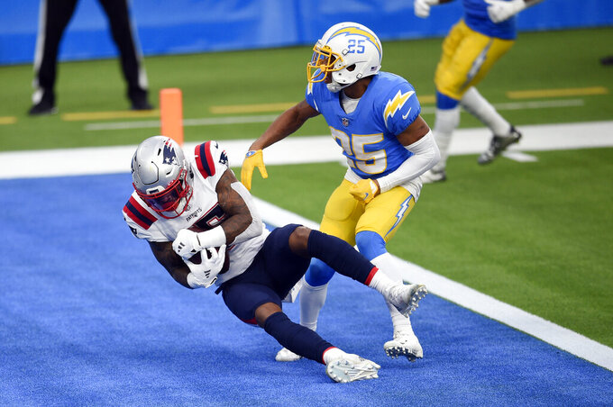 CORRECTS TO SECOND HALF NOT FIRST HALF - New England Patriots wide receiver N'Keal Harry, left, catches a touchdown pass next to Los Angeles Chargers cornerback Chris Harris (25) during the second half of an NFL football game Sunday, Dec. 6, 2020, in Inglewood, Calif. (AP Photo/Kelvin Kuo)