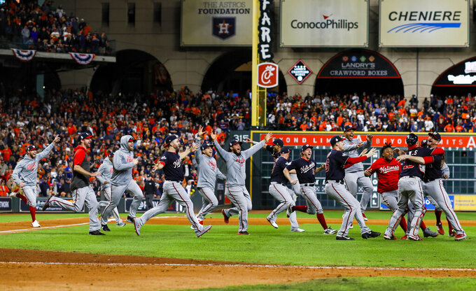 The Washington Nationals celebrate after Game 7 of the baseball World Series against the Houston Astros, Oct. 30, 2019, in Houston. (AP Photo/Matt Slocum)