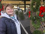 In this Saturday, Dec. 7, 2019 photo, Sandy Parsons is shown at her seasonal stand, at the Capitol Market in Charleston, W.Va. Parsons never received her order of 350 trees this year from a North Carolina farm, citing a short supply. Instead, she was sent a few much-smaller trees to sell at her lot. Christmas trees are in tight supply again this year across the United States, depending upon location and seller, as the industry continues bouncing back from the Great Recession. (AP Photo/John Raby)
