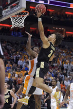 Purdue's Carsen Edwards (3) puts up a shot against Tennessee's Admiral Schofield (5) during overtime of a men's NCAA Tournament college basketball South Regional semifinal game Thursday, March 28, 2019, in Louisville, Ky. (AP Photo/Timothy D. Easley)