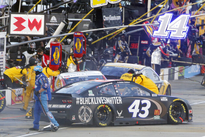 Bubba Wallace (43) makes a pit stop during a NASCAR Cup Series auto race Wednesday, June 10, 2020, in Martinsville, Va. (AP Photo/Steve Helber)