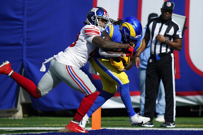 Los Angeles Rams' Darrell Henderson, right, scores a touchdown while New York Giants' Tae Crowder tries to stop him during the first half of an NFL football game, Sunday, Oct. 17, 2021, in East Rutherford, N.J. (AP Photo/Frank Franklin II)