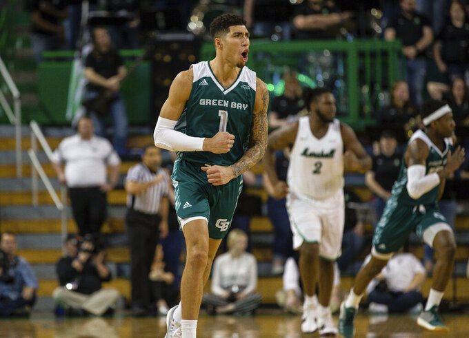 Green Bay's Sandy Cohen III celebrates after knocking down a 3-pointer against Marshall in the championship game of the CollegeInsider.com Tournament on Thursday, April 4, 2019, at the Cam Henderson Center in Huntington, W.Va. (Sholten Singer/The Herald-Dispatch via AP)