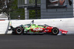 Santino Ferrucci hits the wall in the second turn during practice for the Indianapolis 500 auto race at Indianapolis Motor Speedway in Indianapolis, Thursday, May 20, 2021. (AP Photo/Jamie Gallagher)