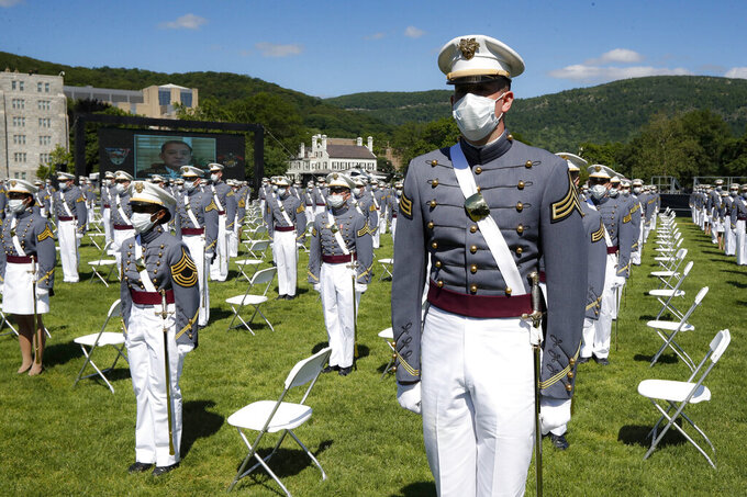 FILE - In this June 13, 2020, file photo, United States Military Academy graduating cadets wear face masks as they stand next to their socially-distanced seats during commencement ceremonies in West Point, N.Y. Most of the 73 West Point cadets accused in the biggest cheating scandal in decades at the U.S. Military Academy are being required to repeat a year, and eight were expelled, academy officials said Friday, April 16, 2021. (AP Photo/John Minchillo, Pool, File)