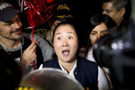 Keiko Fujimori leaves the Santa Mónica women's prison in Lima, Peru, Friday, Nov. 29, 2019. The Constitutional Tribunal narrowly approved a habeas corpus request to free Fujimori from detention while she is investigated for alleged accusations she accepted money from Brazilian construction giant Odebrecht.(AP Photo/Martin Mejia)
