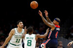 Washington Wizards' Isaiah Thomas passes the ball over Boston Celtics' Kemba Walker and Enes Kanter (11) during the first quarter of an NBA basketball game Wednesday, Nov. 13, 2019, in Boston. (AP Photo/Winslow Townson)