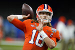 Clemson quarterback Trevor Lawrence warms up before the Sugar Bowl NCAA college football game against Ohio State Friday, Jan. 1, 2021, in New Orleans. (AP Photo/Gerald Herbert)