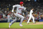 Los Angeles Angels' Shohei Ohtani runs to first after hitting a single during the eighth inning of a baseball game against the San Diego Padres, Tuesday, Sept. 7, 2021, in San Diego. (AP Photo/Gregory Bull)