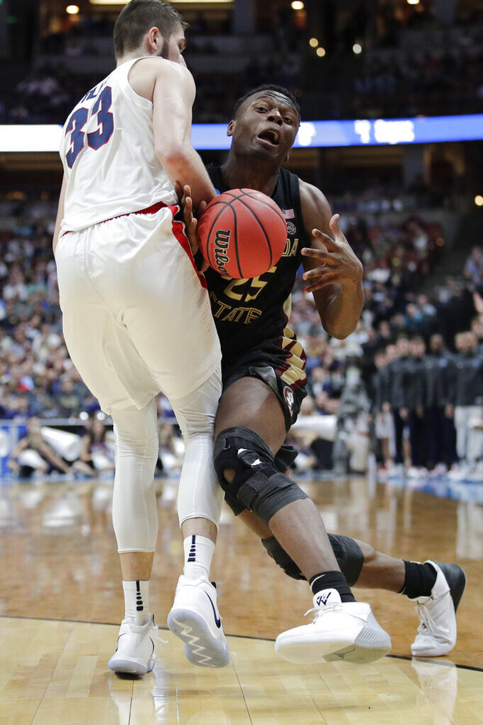 Florida State forward Mfiondu Kabengele, right, collides with Gonzaga forward Killian Tillie during the second half an NCAA men's college basketball tournament West Region semifinal Thursday, March 28, 2019, in Anaheim, Calif. (AP Photo/Jae C. Hong)