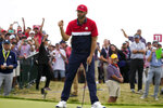 Team USA's Dustin Johnson reacts to his putt on the 15th hole during a Ryder Cup singles match at the Whistling Straits Golf Course Sunday, Sept. 26, 2021, in Sheboygan, Wis. (AP Photo/Charlie Neibergall)