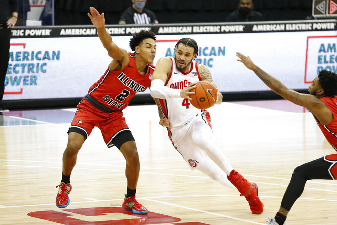 Ohio State's Duane Washington, right, drives the lane as Illinois State's Josiah Strong defends during the second half of an NCAA college basketball game Wednesday, Nov. 25, 2020, in Columbus, Ohio. Ohio State beat Illinois State 94-67. (AP Photo/Jay LaPrete)