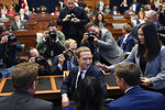 Facebook Chief Executive Officer Mark Zuckerberg, front center, turns back and smiles after arriving for a hearing before the House Financial Services Committee on Capitol Hill in Washington, Wednesday, Oct. 23, 2019. (AP Photo/Susan Walsh)