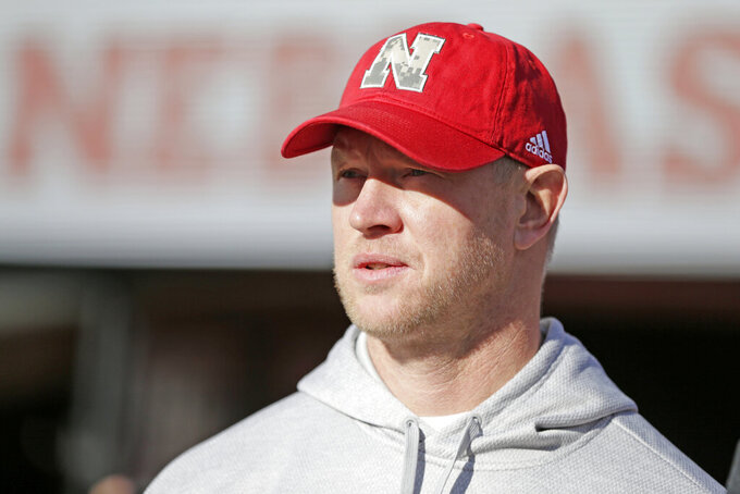 Nebraska head coach Scott Frost watches warmups before an NCAA college football game against Wisconsin in Lincoln, Neb., Saturday, Nov. 16, 2019. (AP Photo/Nati Harnik)