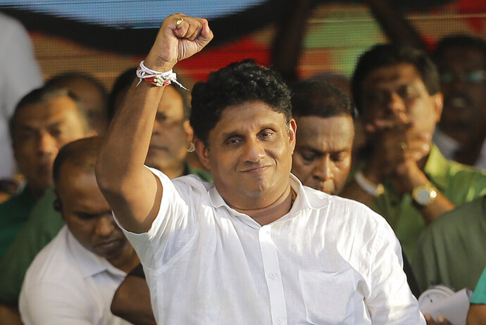 Presidential candidate of Sri Lanka's governing party Sajith Premadasa gestures during his maiden election campaign rally in Colombo, Sri Lanka, Thursday, Oct. 10, 2019. Premadasa says he will put a former army chief in charge of national security if he wins, an apparent move to counter former defense chief and front-runner Gotabaya Rajapaksa, whose campaign centers on security following last Easter's deadly suicide bomb attacks.(AP Photo/Eranga Jayawardena)