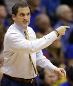 Iowa State coach Steve Prohm gestures to his team during the first half of an NCAA college basketball game against Kansas in Lawrence, Kan., Tuesday, Jan. 9, 2018. (AP Photo/Orlin Wagner)