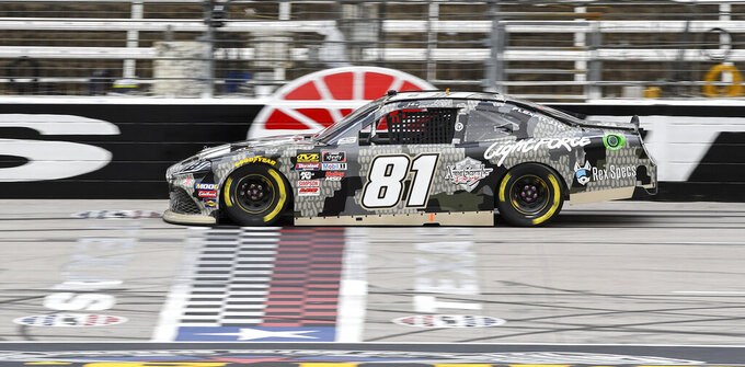 Driver Jeffery Earnhardt races down the front stretch during qualifying for a NASCAR auto race at Texas Motor Speedway, Saturday, March 30, 2019, in Fort Worth, Texas. (AP Photo/Larry Papke)