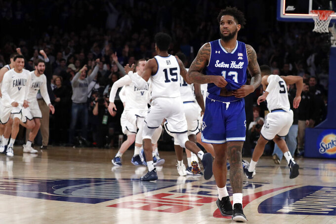 Seton Hall guard Myles Powell, front, leaves the court as Villanova players celebrate after winning 74-72 in an NCAA college basketball game in the championship of the Big East Conference tournament, Saturday, March 16, 2019, in New York. (AP Photo/Julio Cortez)