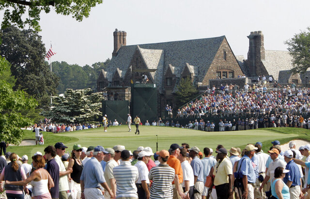 FILE - In this June 18, 2006, file photo, Phil Mickelson and Kenneth Ferrie are shown on the ninth green during the final round of the U.S. Open golf tournament at Winged Foot Golf Club in Mamaroneck, N.Y. The U.S. Open returns to Winged Foot next week, held in September because for the first time since 1913.  (AP Photo/Morry Gash, File)