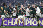 South Africa's Cheslin Kolbe sprays champagne as he celebrates with his teammates after they defeated England in the Rugby World Cup final at International Yokohama Stadium in Yokohama, Japan, Saturday, Nov. 2, 2019. (AP Photo/Mark Baker)
