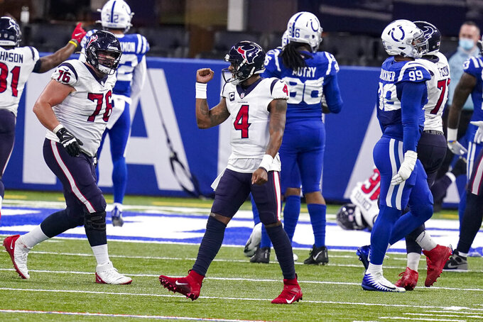 Houston Texans quarterback Deshaun Watson (4) celebrates after a throw for a touchdown against the Indianapolis Colts in the second half of an NFL football game in Indianapolis, Sunday, Dec. 20, 2020. (AP Photo/Darron Cummings)