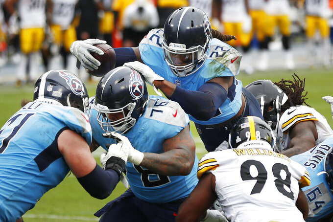 Tennessee Titans running back Derrick Henry (22) follows the blocking of offensive guard Rodger Saffold (76) as Henry scores a touchdown against the Pittsburgh Steelers in the second half of an NFL football game Sunday, Oct. 25, 2020, in Nashville, Tenn. (AP Photo/Wade Payne)