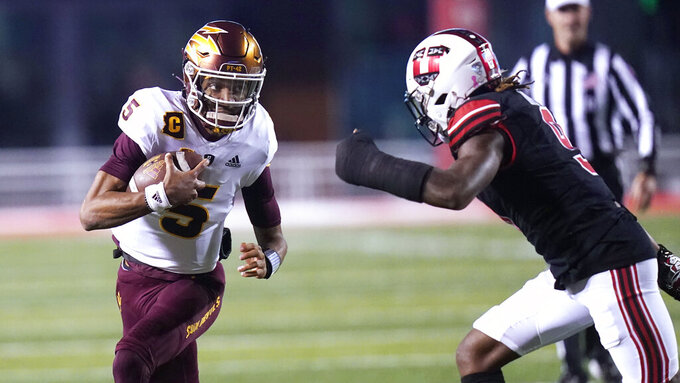 Arizona State quarterback Jayden Daniels (5) carries the ball as Utah safety Vonte Davis (9) defends during the first half of an NCAA college football game Saturday, Oct. 16, 2021, in Salt Lake City. (AP Photo/Rick Bowmer)