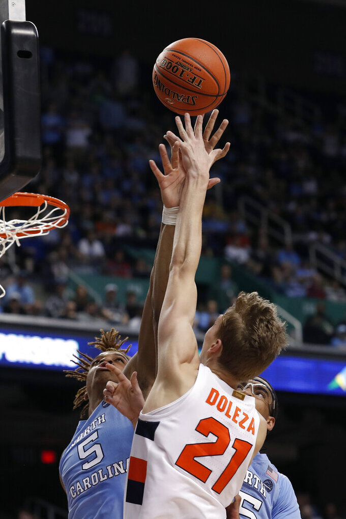 Syracuse forward Marek Dolezaj (21) shoots over North Carolina forward Armando Bacot (5) during the first half of an NCAA college basketball game at the Atlantic Coast Conference tournament in Greensboro, N.C., Wednesday, March 11, 2020. (AP Photo/Gerry Broome)