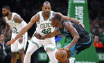 Boston Celtics center Al Horford (42) tries to trap Charlotte Hornets center Bismack Biyombo (8) during the first quarter of an NBA basketball game in Boston, Wednesday, Jan. 30, 2019. (AP Photo/Charles Krupa)