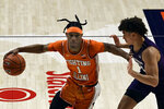 Illinois guard Trent Frazier (1) powers past Northwestern's guard Ty Berry (3) in the first half of an NCAA college basketball game Tuesday, Feb. 16, 2021, in Champaign, Ill. (AP Photo/Holly Hart)
