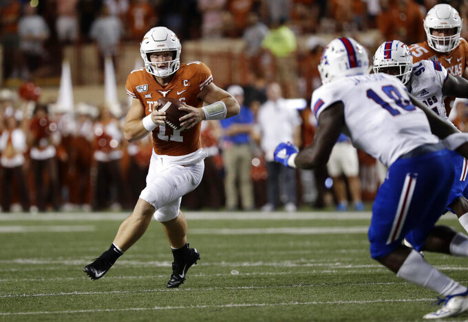 Texas quarterback Sam Ehlinger (11) runs against Louisiana Tech during the first half of an NCAA college football game, Saturday, Aug. 31, 2019, in Austin, Texas. (AP Photo/Eric Gay)