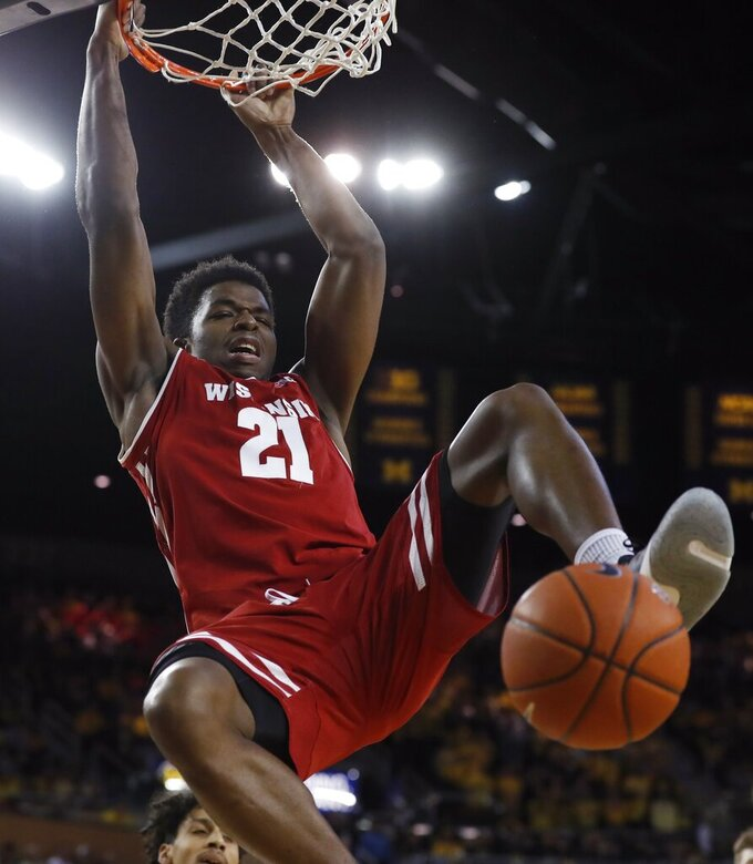 Wisconsin guard Khalil Iverson dunks during the first half of an NCAA college basketball game against Michigan, Saturday, Feb. 9, 2019, in Ann Arbor, Mich. (AP Photo/Carlos Osorio)