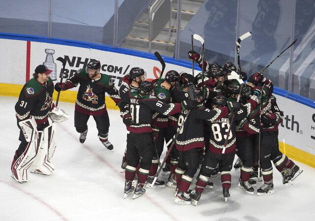 Arizona Coyotes celebrate their win over the Nashville Predators following overtime of an NHL hockey playoff game Friday, Aug. 7, 2020, in Edmonton, Alberta. (Jason Franson/Canadian Press via AP)  AP)