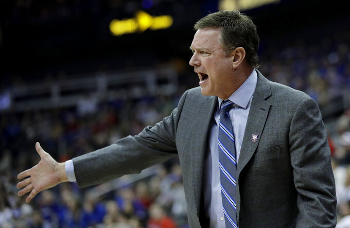 Kansas coach Bill Self talks to a player during the second half of the team's NCAA college basketball game against West Virginia in the Big 12 men's tournament Friday, March 15, 2019, in Kansas City, Mo. Kansas won 88-74. (AP Photo/Charlie Riedel)