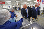 Vice President Mike Pence tours medical-device manufacturer Merit Medical with Fred Lampropoulos, Merit Medical chairman and CEO, Thursday, Aug. 22, 2019, in South Jordan, Utah.  Pence is visiting Utah as the next stop on a trip to promote the Trump administration's trade deal with Mexico and Canada.   (AP Photo/Rick Bowmer, Pool)