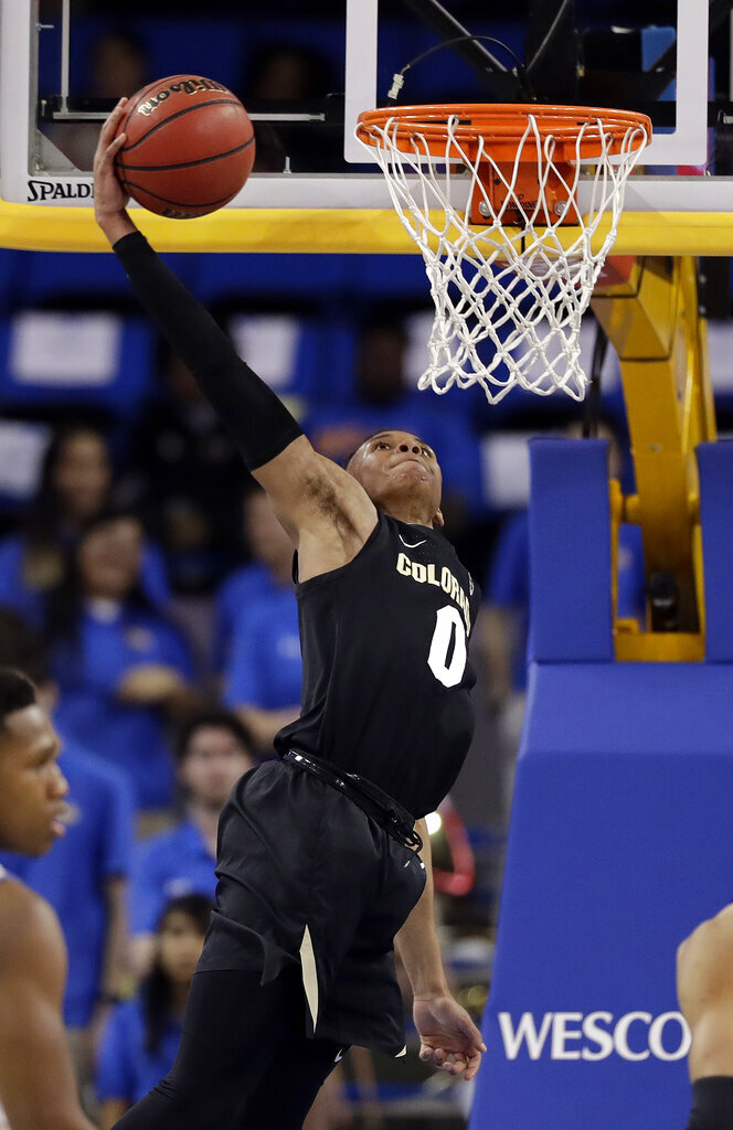 Colorado guard Shane Gatling goes up for a dunk against UCLA during the second half of an NCAA college basketball game Wednesday, Feb. 6, 2019, in Los Angeles. (AP Photo/Marcio Jose Sanchez)