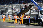 The car of Williams driver Robert Kubica of Poland is removed from the track after crashing during the qualifying session for the Japanese Formula One Grand Prix at Suzuka Circuit in Suzuka, central Japan, Sunday, Oct. 13, 2019. (Kim Hong-Ji/Pool Photo via AP)