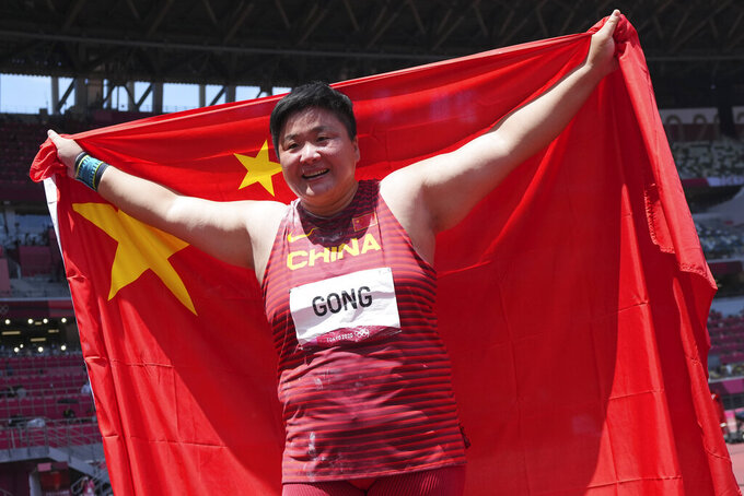 Gong Lijiao, of China, celebrates after winning the gold medal in the final of the women's shot put at the 2020 Summer Olympics, Sunday, Aug. 1, 2021, in Tokyo. (AP Photo/Matthias Schrader)
