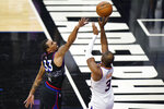 Phoenix Suns' Chris Paul, right, goes up for a shot against Philadelphia 76ers' George Hill during the second half of an NBA basketball game, Wednesday, April 21, 2021, in Philadelphia. (AP Photo/Matt Slocum)