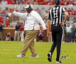 In this Sept. 16, 2017 photo Ruffin McNeill, assistant head coach and defensive tackles coach walks onto the field during a college football game between the University of Oklahoma Sooners (OU) and the Tulane University Green Wave at Gaylord Family-Oklahoma Memorial Stadium in Norman, Okla. Oklahoma fired defensive coordinator Mike Stoops on Monday, Oct. 8, 2018 after the Sooners struggled to stop Texas during their first loss of the season. McNeill will be the defensive coordinator for the rest of the season. (Steve Sisney/The Oklahoman via AP)