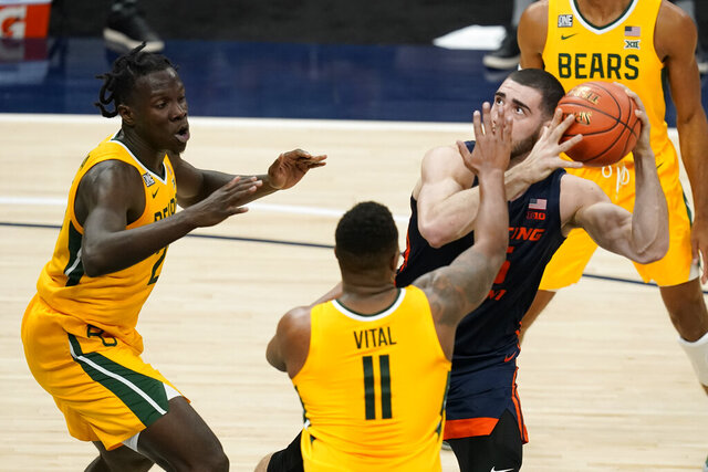 Illinois' Giorgi Bezhanishvili (15) looks to shoot as Baylor's Mark Vital (11) and Jonathan Tchamwa Tchatchoua (23) defend during the first half of an NCAA college basketball game Wednesday, Dec. 2, 2020, in Indianapolis. (AP Photo/Darron Cummings)