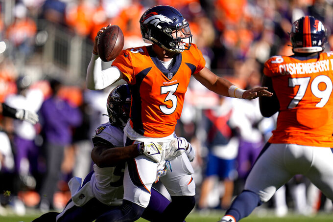 Denver Broncos quarterback Drew Lock (3) is hit by Baltimore Ravens outside linebacker Justin Houston during the second half of an NFL football game, Sunday, Oct. 3, 2021, in Denver. (AP Photo/Jack Dempsey)
